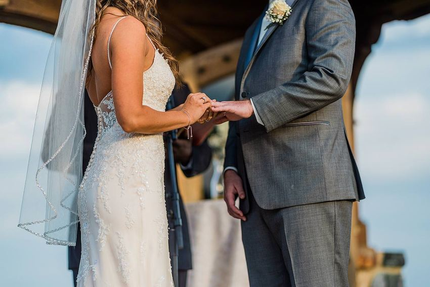 creative ceremony photo of ring exchange at wyndridge farm wedding by Washington DC Wedding Photographer Adam Mason