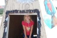 Megan in a teepee