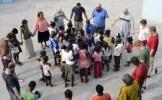 Praying for the children at Good Shepherd
