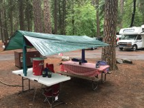 """After the rains came I got to make a little covering for our cooking area. This became our """"warm spot"""" for the rest of the trip."""