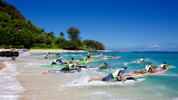 A race from shore into the surf kicks off the Na Pali Race. Competitors will have to make good choices along the waves to maximize speed with minimal effort. Lia Barrett