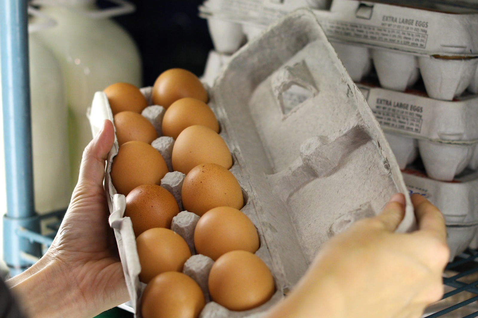 A customer checks their eggs