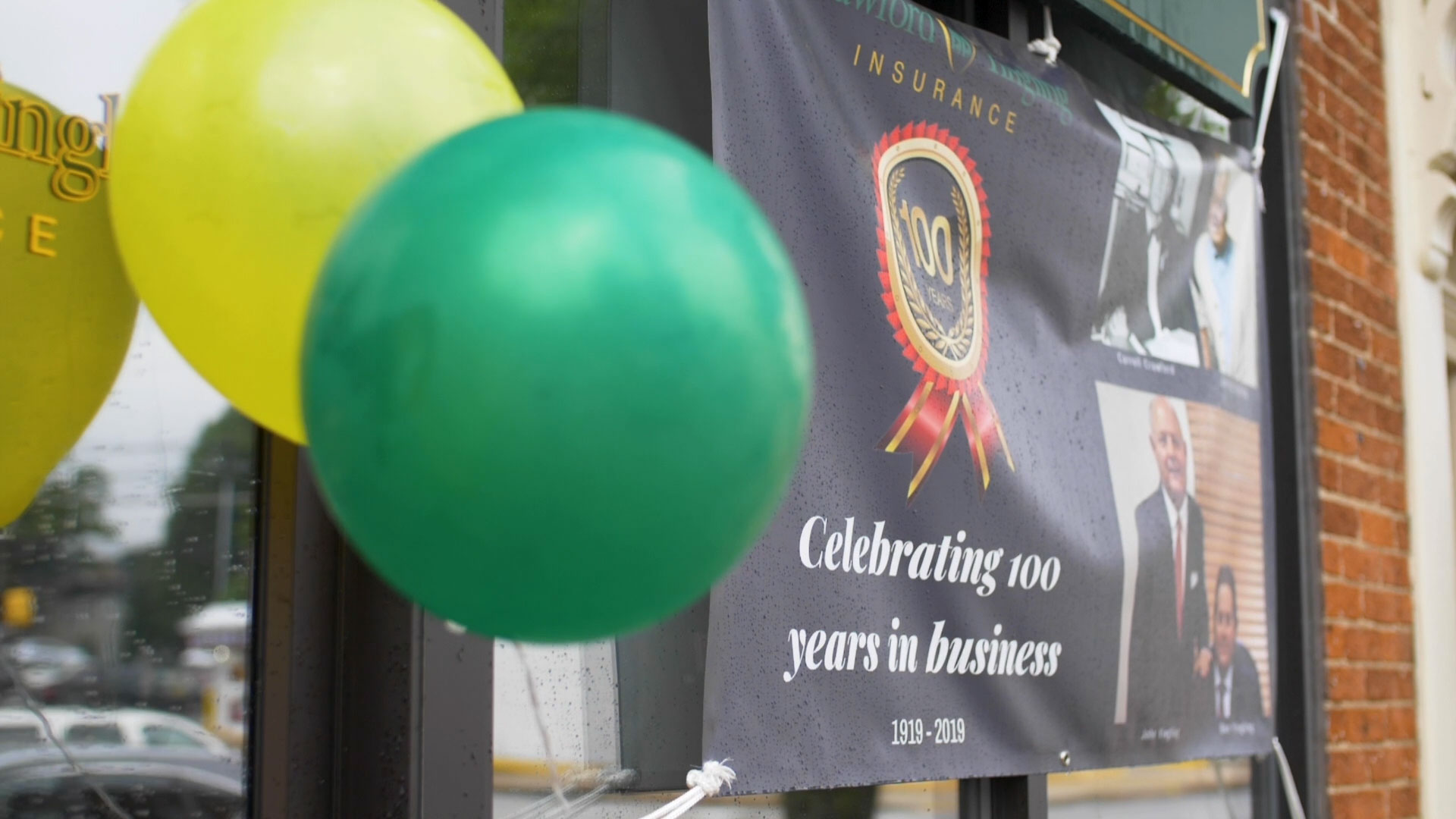 celebrating-100-years-balloons-green-yellow