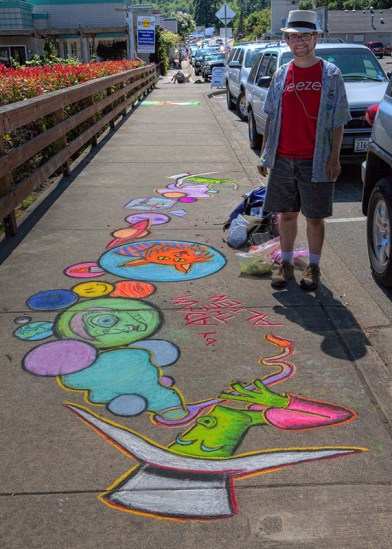 Adam standing next to his Chalk the Walk 2009 piece. Photo by Kelly Bailey (flickr: kellbailey).