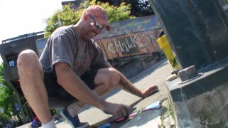 Brian just can't stop chalking, even when he's finished his piece.