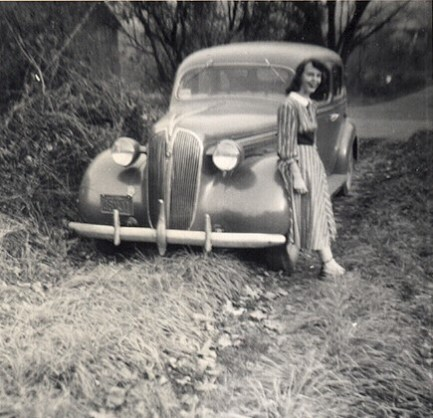 Joan in the fall of 1949 in front of a 1937 Plymouth