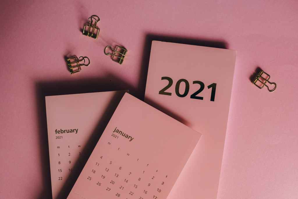 contemporary monthly calendars and clips on pink table