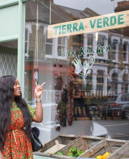 Adaora Soludo in front of gluten free vegan cafe in london
