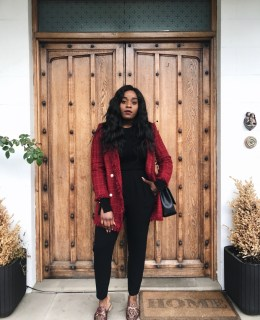 Adaora Soludo in a red Zara Coat