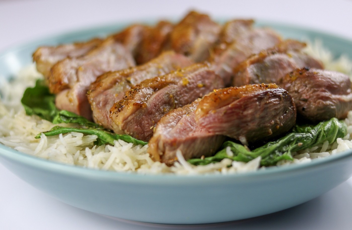 Duck A L'Orange on a bed of Pak Choi and Rice
