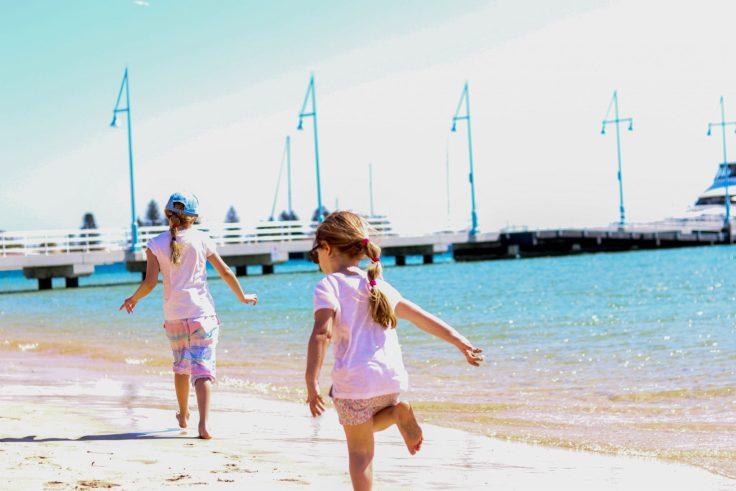 girls running on the beach