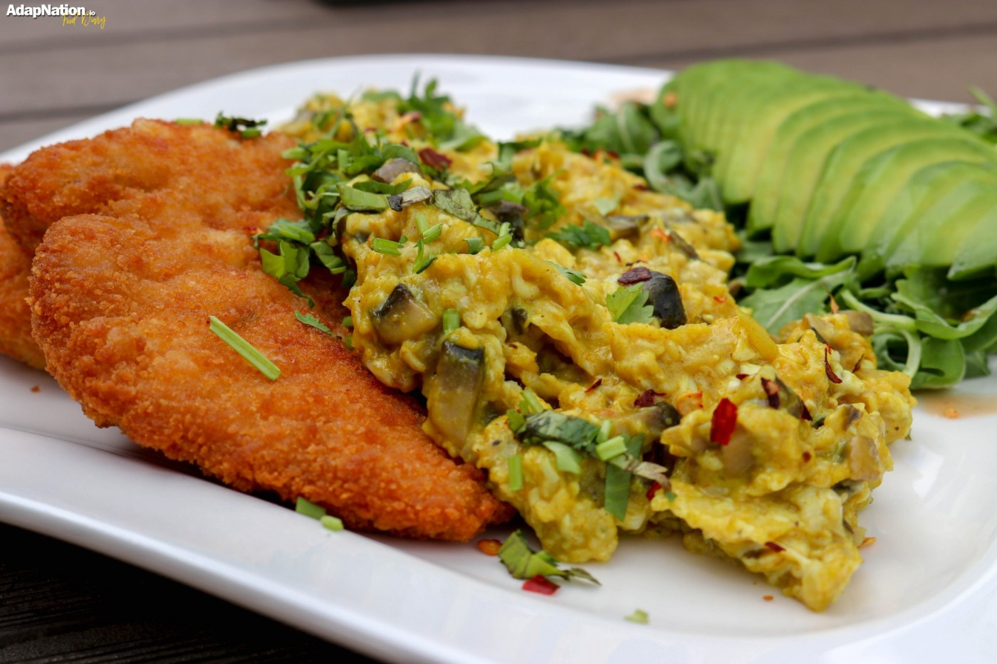 Eggs-A-La-Michelle, with Chicken Schnitzel, Avo and Rocket Salad