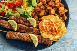 Lamb Adana Kebabs, Crispy Roasties, Halloumi & Salad
