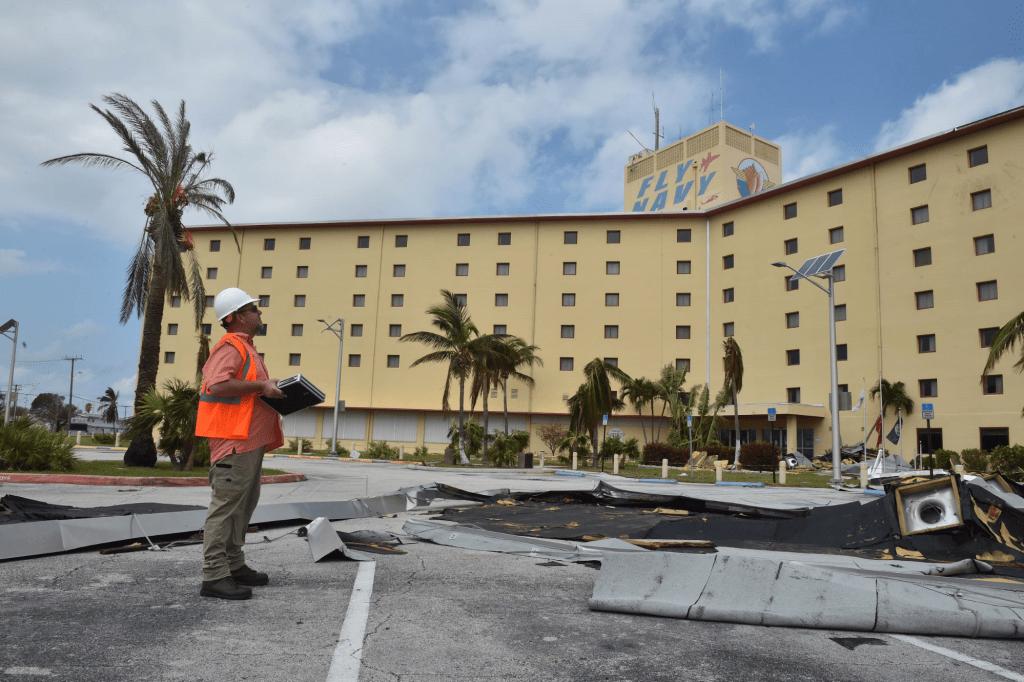 NAVFAC engineer Robert Long, from Omaha, Nebraska, surveys damage at NAS Key West after Hurricane Irma.