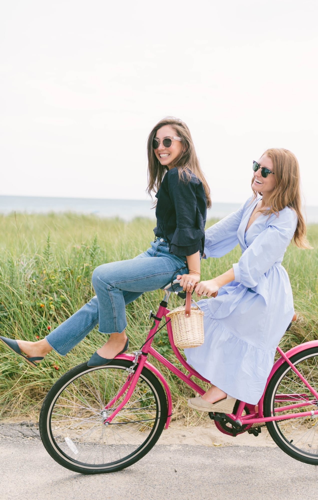 Mackenzie and Ali on a pink bike