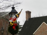 A wreath and Maryland flag decorate lamp posts around State Circle.