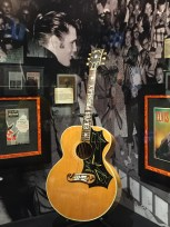 Elvis' guitar rests in a place of honor among the exhibits in the Trophy Room.