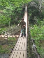 Daddy walking Angela across bridge