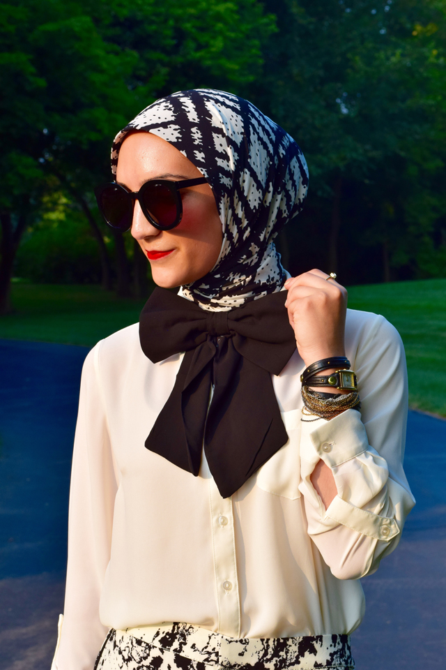 A Day In The Lalz; Fashion; Modesty; Black and White; Put a Bow On it; Chic; Modesty; Banana Republic Piped Printed Soft Pant; ASOS Oversized Bow Tie; Karen Walker Super Duper Black; Stila Beso; Rockstud T-Strap Pump; La Mer Watch; The Limited Ashton Blouse; Zeena Scarf