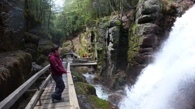 The Flume Gorge is one of the best activities in New Hampshire. You must check out its granite cliffs.
