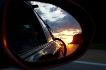Beautiful sunrise in the sideview mirror.