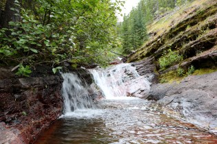 Small waterfall on the Lower & Upper Rowe Lake trail in Waterton Lakes National Park.