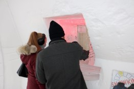 Bryan and Nicole purchasing their Snowking passes at the ticket booth in the Snowking Castle