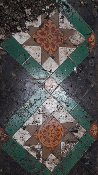 Floor tiles in the main hall at Crawford Priory