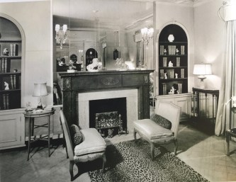 exotic leopard carpet and mirrored fireplace surround