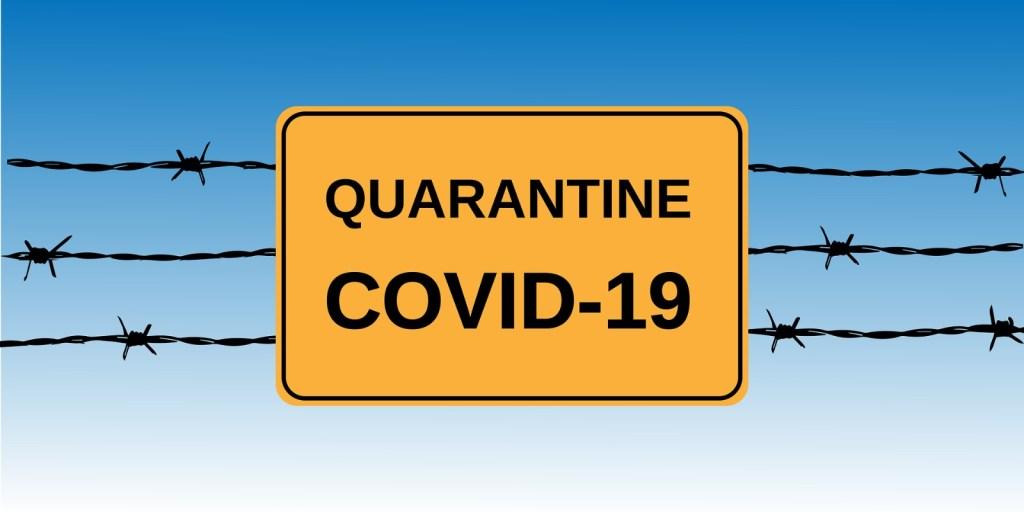"""Imagen de una valla tipo """"concertina"""" con el cartel: Quarantine  COVID -19"""