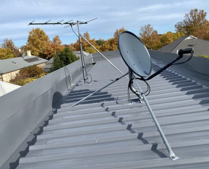 A rooftop satellite and antenna Norwood