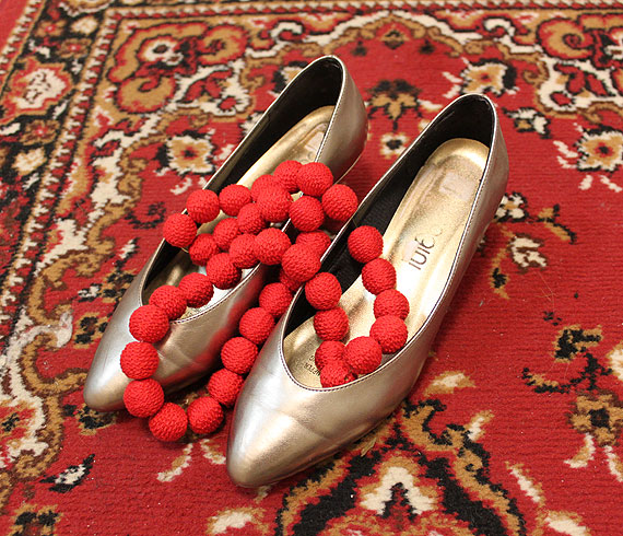 gold shoes and red necklace