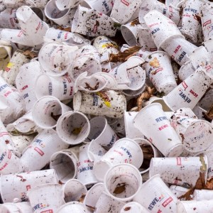 Image of dirty plastic cups showing food waste trash.