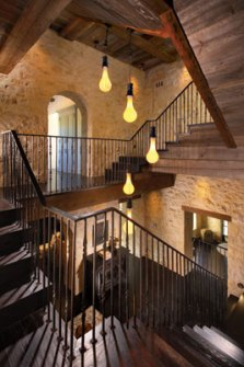 Stair Foyer Iron Rails And Light Fixtures