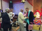 Singer Buddhadevbhai Kansara felicitates Chief Commander Nick Downing