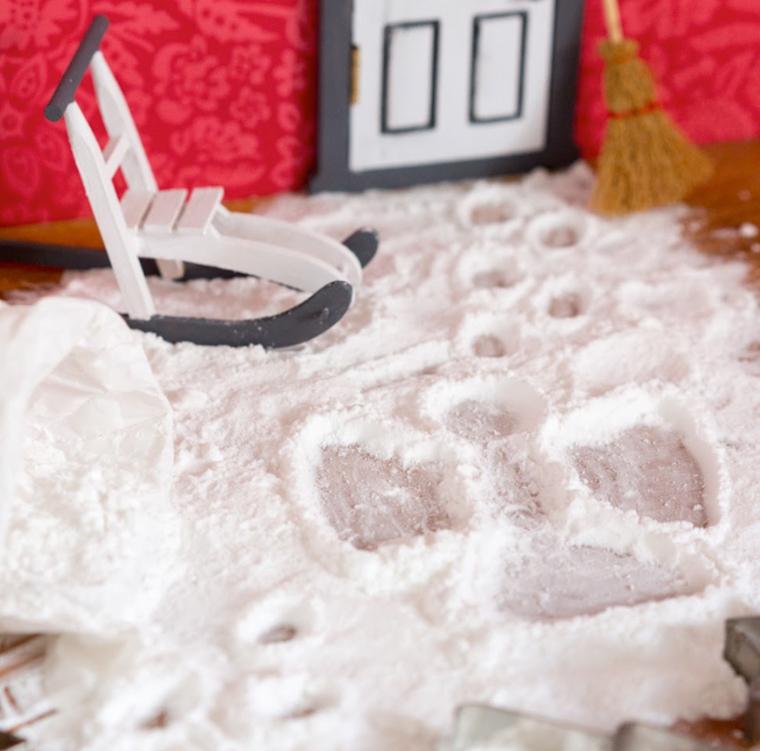 nisse har gjort snöängel i mjöl