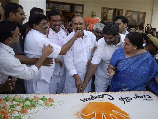 CONGRESS ENJOYING THE FRUITS OF UNITY -Congress party supporters offer cake to Andhra Pradesh state Chief Minister and Congress party leader Y.S. Rajasekhara Reddy, center, at his office in Hyderabad, India, Saturday, May 16, 2009. The Congress party headed to a resounding victory Saturday in India's monthlong national elections, defying expectations of a poor showing to secure a second term in power as the country battles an economic downturn. (AP Photo/Mahesh Kumar A)