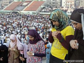 Egyptian women perform the Eid al-Fitr dawn prayer at a stadium in Mansura, 120 km north of Cairo.