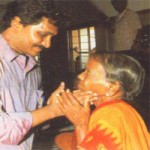 Jagan Mohan  who has the caring touch of YSR, with a Flood victim in Cuddapah.