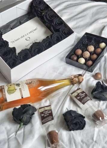 Enchanted black roses and chocolates