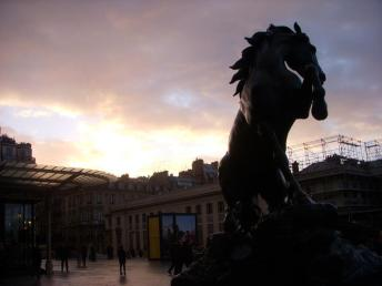 A horse statue bucks at the sunset in front of the Musée d'Orsay.