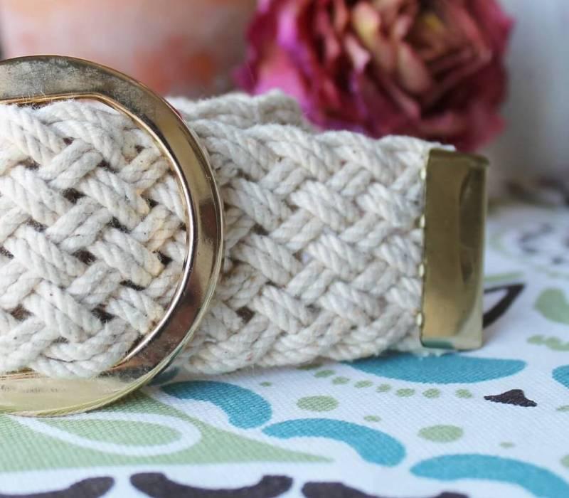 Close up of metal end of belt bracelet