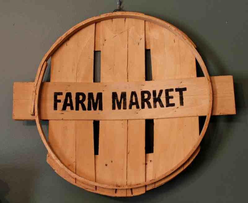 farm market sign on vintage wood