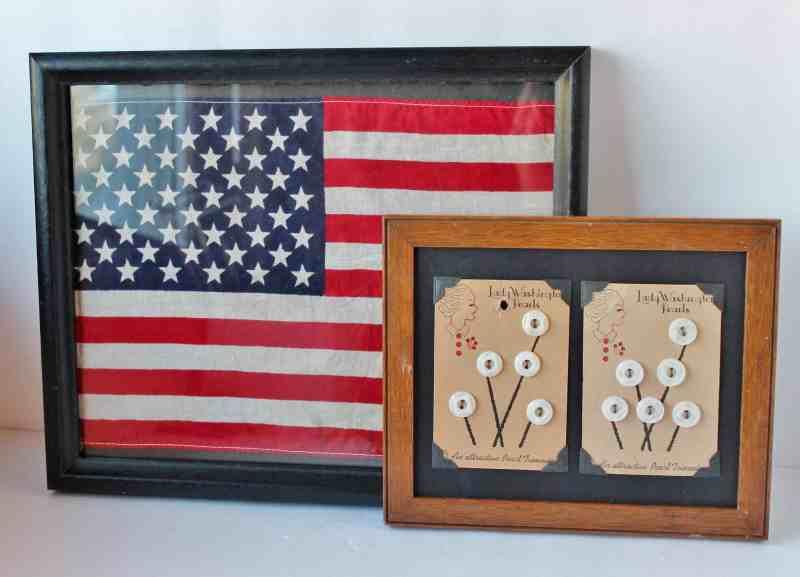 Framed vintage flag and framed vintage buttons