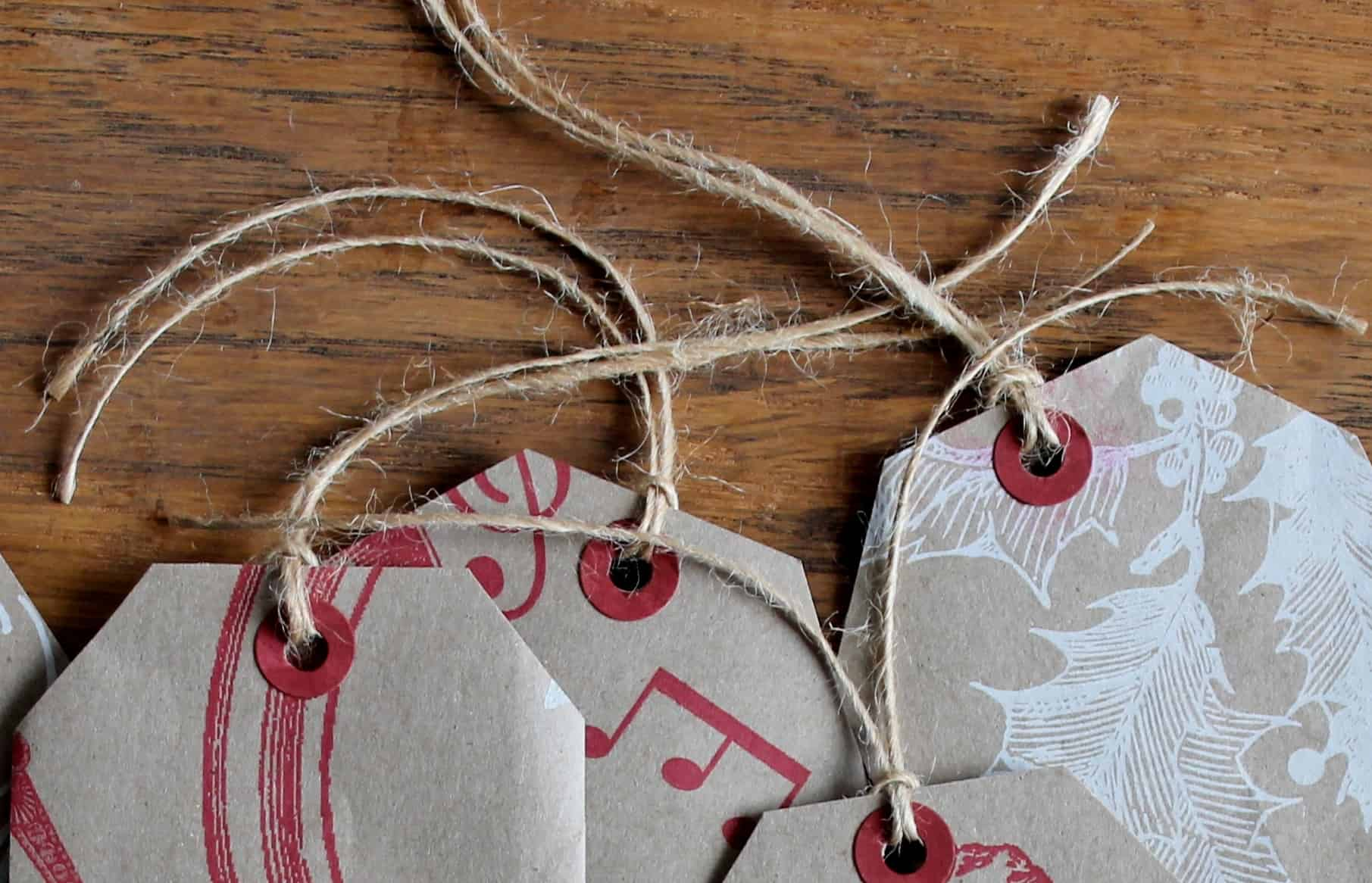 Close up of twine threaded through Trader Joe gift tags