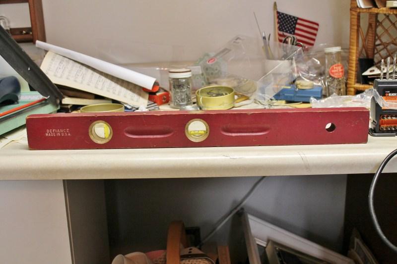 Vintage level sitting on my messy workbench