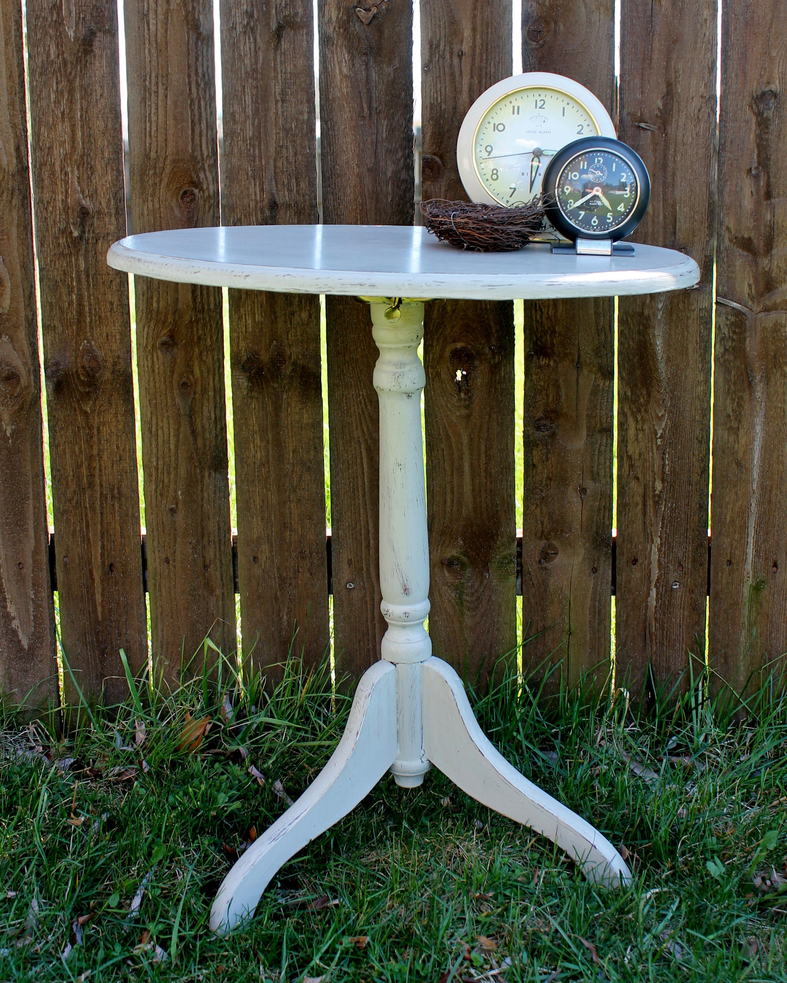 Chalk painted tilt top table with vintage clocks