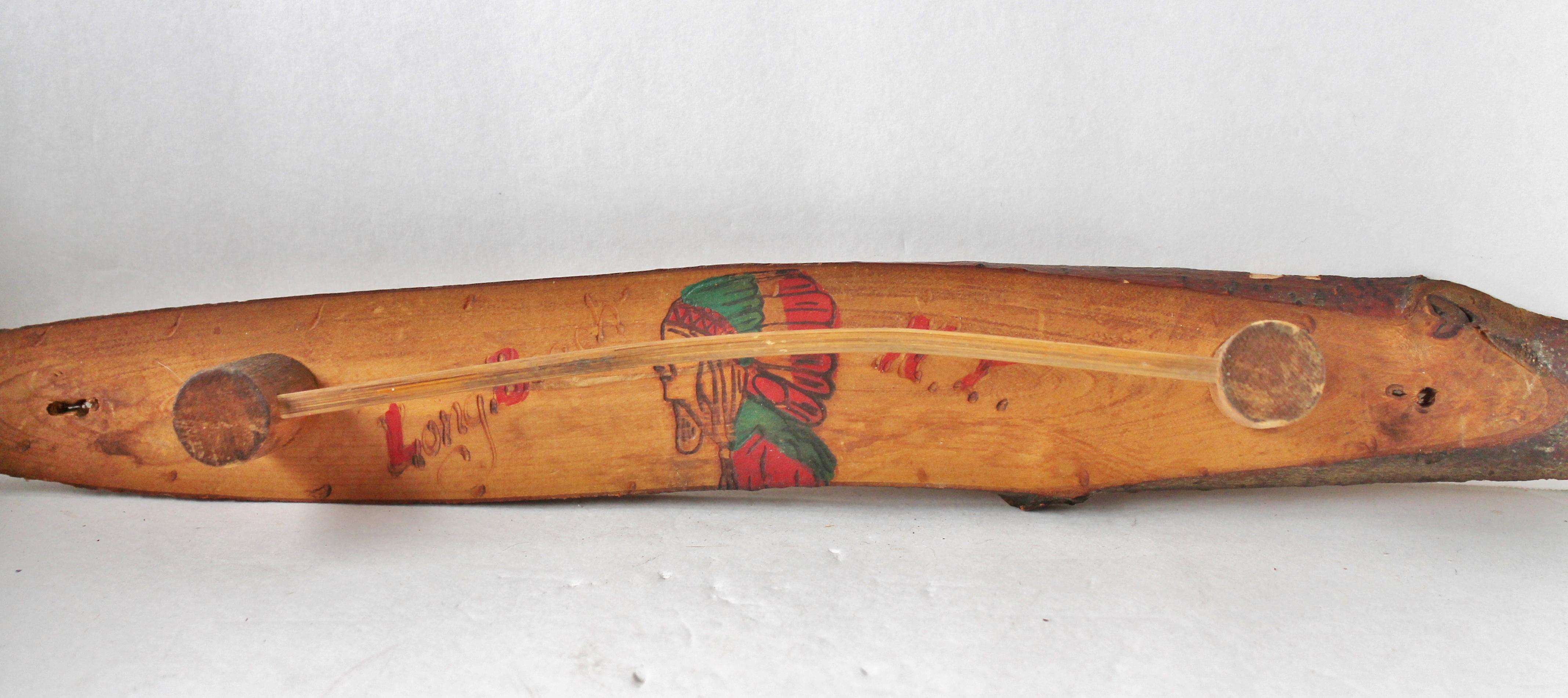 Wood-burned souvenir rack with American Indian head