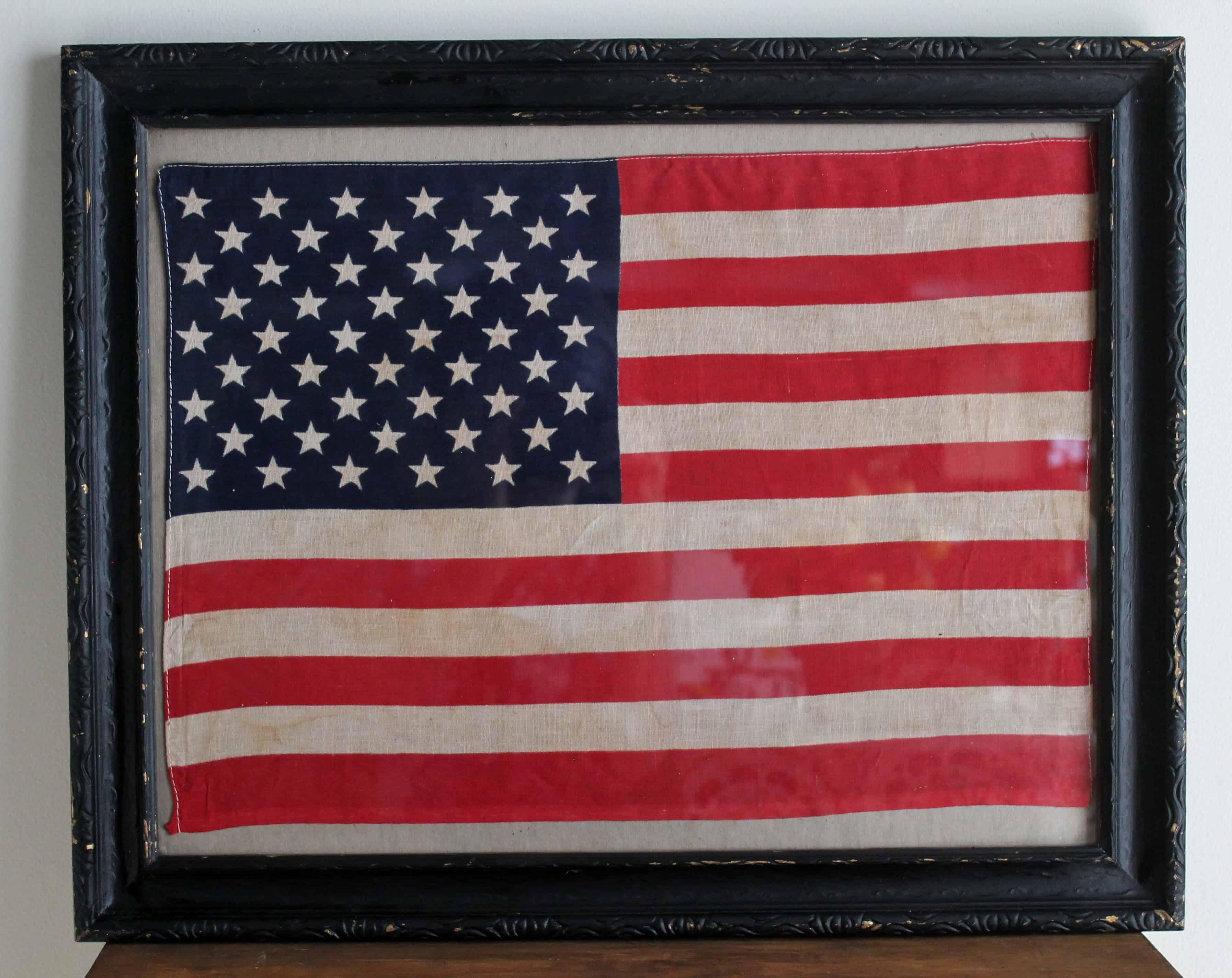 Vintage tea dyed american flag in vintage black frame