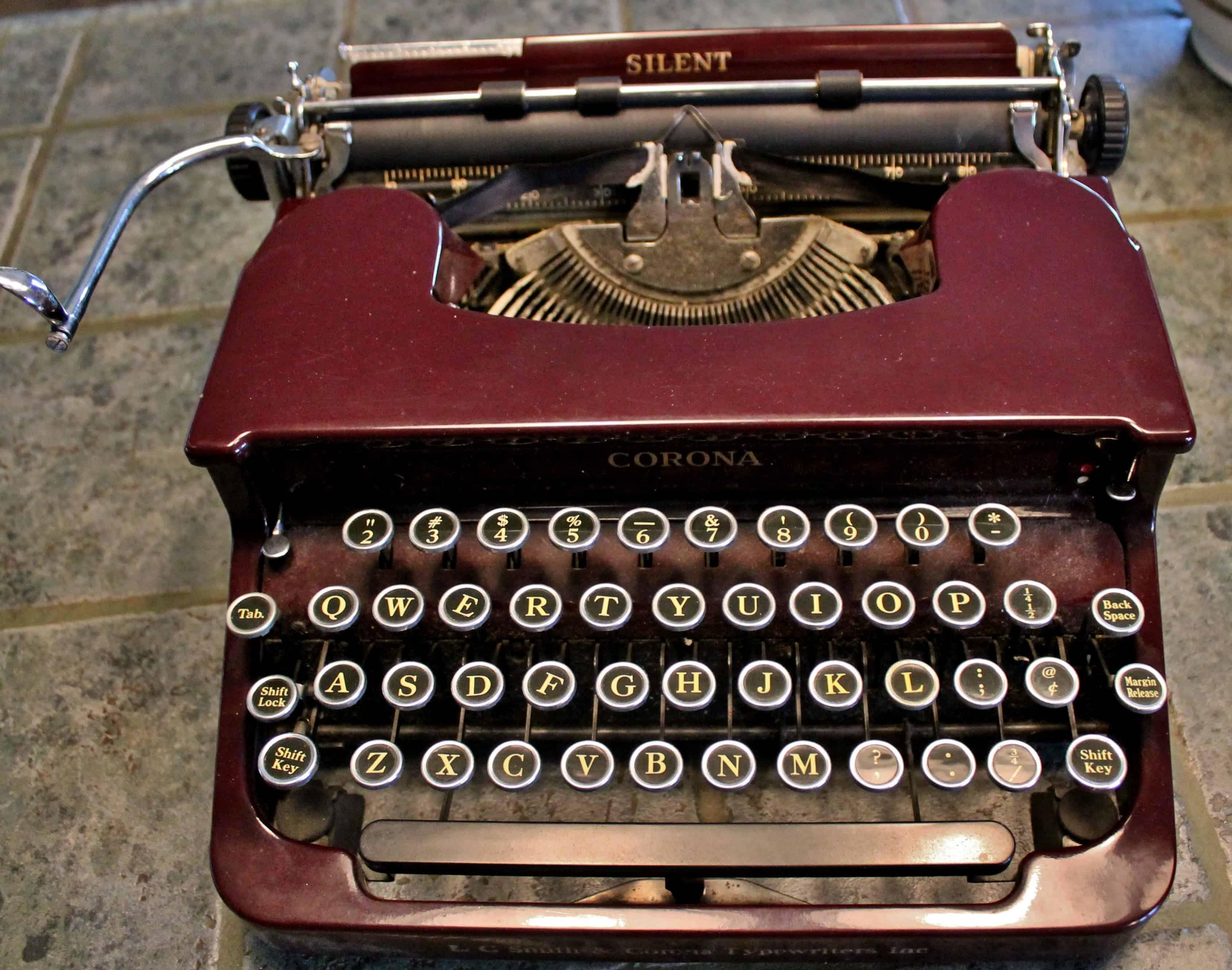 Antique Corona Typewriter in maroon